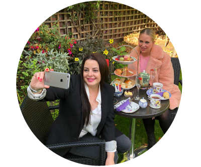 Two beautiful women take a selfie while enjoying Afternoon tea with prosecco at their home in Dublin
