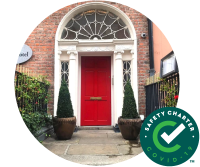 Red Georgian Castle Hotel Dublin Door with Failte Ireland Safety Charter Mark