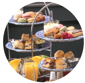 Two afternoon tea stands with scones desserts and sandwiches at the Old Music Shop Restaurant Dublin