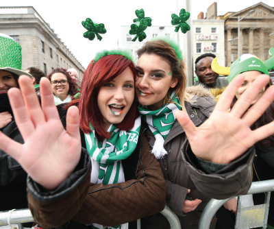 Having Fun on St Patrick's Day Girls with Shamrock Headbands on O Connell Street Dublin 1